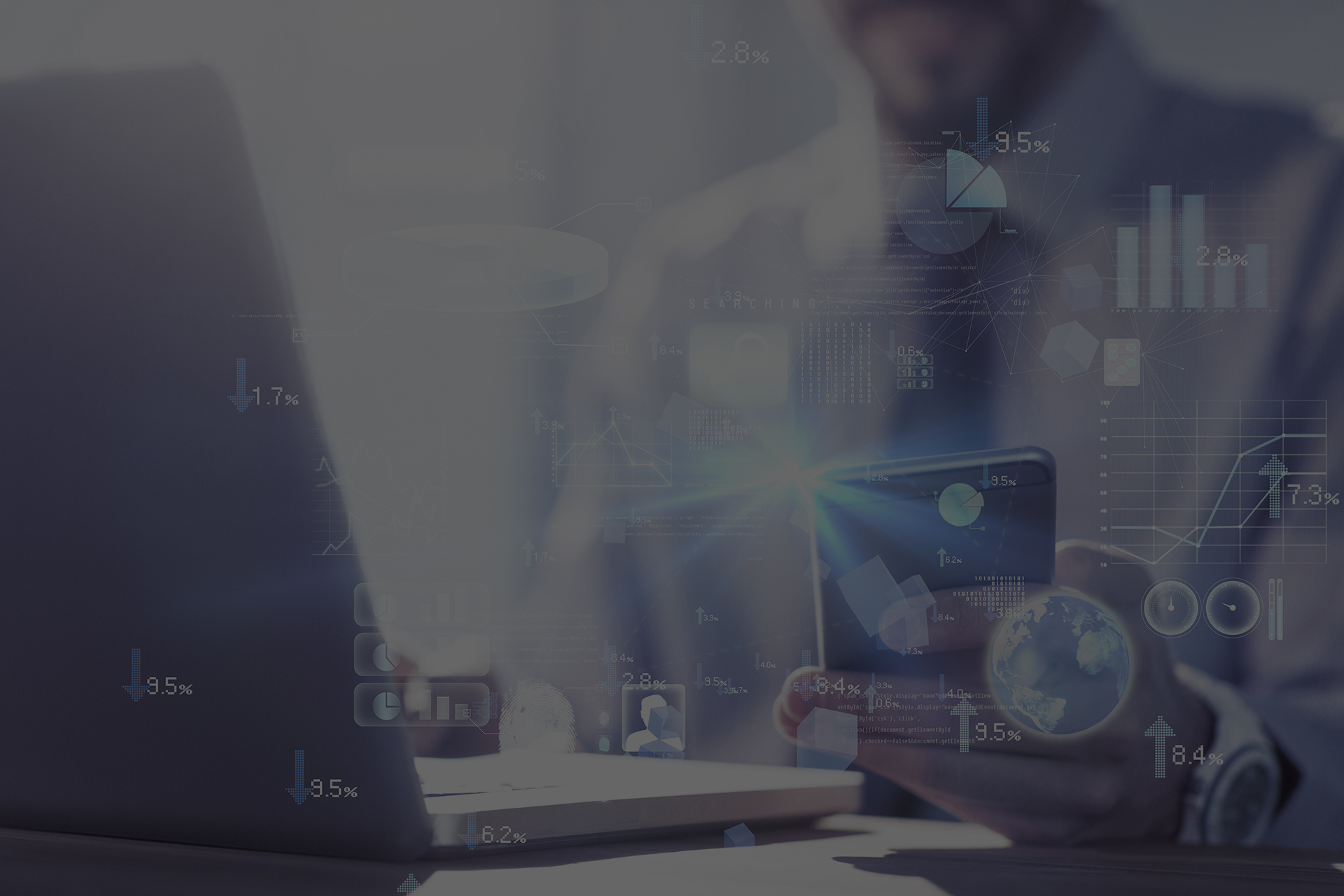 Global technology background against businessman using laptop at desk